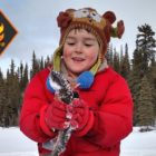 Adorable Alaska child ice fishing bloopers rainbow trout